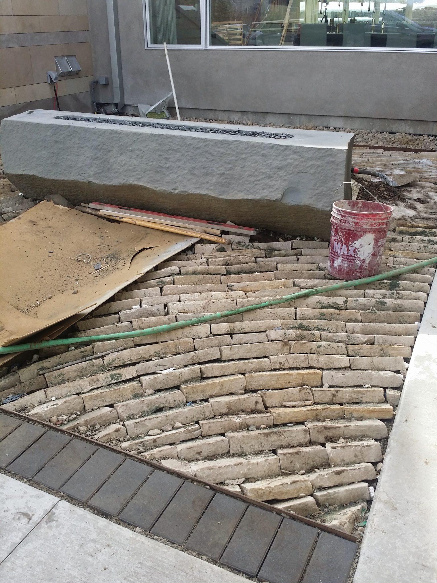Laid stone mulch around fire feature
